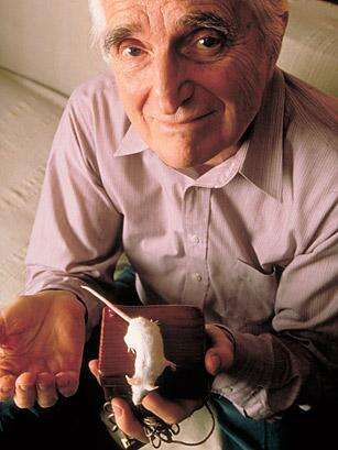 Douglas Englebart, a mouse, and the mouse that made popular computing happen.(Source: John Storey for TIME)