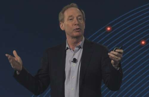 Microsoft's Brad Smith announced a 34-company cybersecurity accord and called for a digital Geneva Convention. (Images: EE Times)